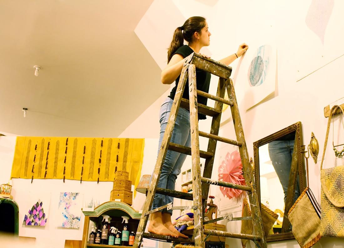 Artist Amanda Michele setting up her show 'Aura' in Brooklyn